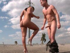 Killer body Sonia Carrere is seductively stroking her sexy oiled body under the opened sky