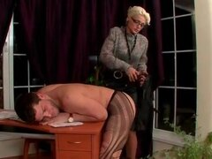 Sub guy in ripped pantyhose spanked by mistress