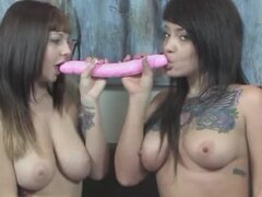 Two sexy tattooed girls with double dildo