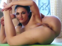 Brunette Logan Drae shows off her flexible shape