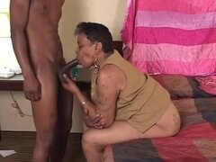 Ebony granny sucks a black cock before taking it...