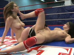 Lesbians wrestle for control as they try to make the other one cum