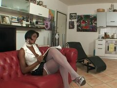 Hot black tranny fucks a guy in his tight ass on a sofa