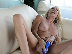 Sexy blonde mature drives a blue dildo deep in her pussy and enjoys pure pleasure