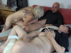 Fiery blonde heats up mature couple on bed