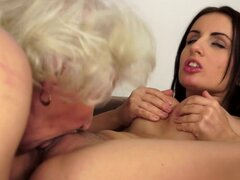 Sexy brunette gets her nipples sucked and eats a hairy pussy