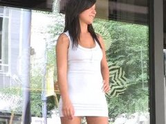 Short white dress becomes transparent when getting wet