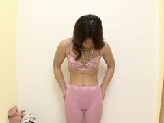 Fresh Japanese gets naked to try on some lingrie in the lingerie shop spy cam video