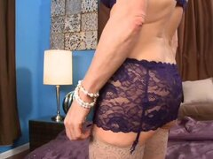 A gorgeous granny has her luscious lingerie on to play with herself in her bedroom