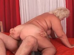 Fat blonde mature takes a seat on dick