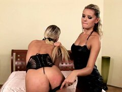 With her hands tied to the bed, the sexy blonde gets her lovely ass spanked hard