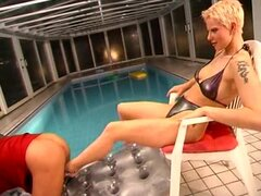 Dominant girl in high heels and bikini plays with him