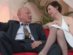 Mature couple get down and dirty in the living room