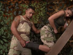 Military lady is sucking and wanking hot dick