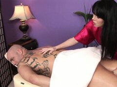 Bald guy gets his body massaged by the hot brunette MILF that is willing to give him a happy ending