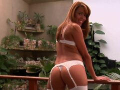 Brazilian lady Aline in white white lingerie in black high heels exposes her sexy ass and legs on the balcony before she dildo fucks her shaved latin pussy in the bedroom. She fills her hole with fake cock.