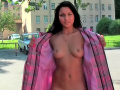 Girl opens the overcoat and flashes her pussy