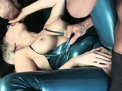 Busty blonde in latex gets hammered by one cock and sucks another