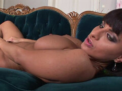 Brunette with a big boobies Veronica Vanoza on the sofa