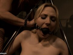 After a good whippin', the mistress gags this naughty blonde in chains