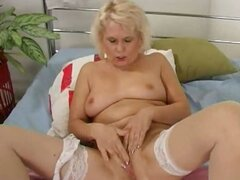 Amazing blonde granny in stockings Leona fingering her wet cooter