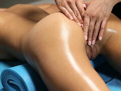 A naked oily massage, how can the masseuse keep her clothes on?
