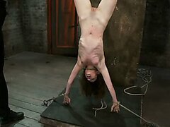 Petite skinny brunette hanged upside-down and forced to deepthroat