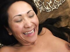 Asian brunette MILF is fucked by young lover