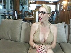 Blond MILF stockings glasses couch bang