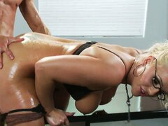 Busty blonde MILF Sadie is getting drilled from behind over the desk