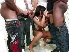 Heavy chested brunette gets her face covered in cum in interracial gang bang
