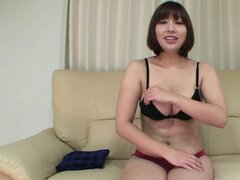 Busty cutie Tomoko gets naked to show her fine ass and nice boobs