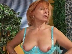Old redhead guides toy into her hairy pussy