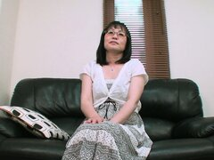 Asian Milf Kazuyo sits on the couch chatting about what she knows
