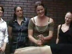 Three girls watch a handjob being given