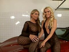 Hot Lesbians In Fishnet On Top Of A Car