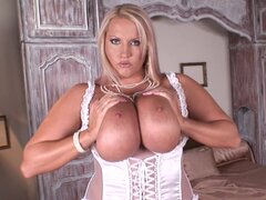 Fatty blonde Laura Orsolya poses in the bedroom in her stockings