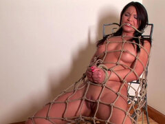 Chubby babe Lana is sitting naked and tied with ropes