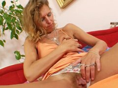 Mature solo banging her hairy cunt