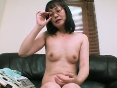 Kazuyo's hairy MILF pussy getting stimulated with a vibrator