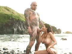 Hottie Tera Patrick takes a dick deep in her mouth by the ocean.