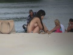 Beach voyeur video of shy topless girl sunbathing