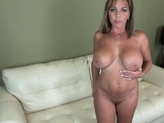 Amber Lynn Bach spreads her pussy lips while fucking herself