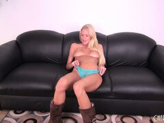 Hot blonde Riley Evans lies fully naked on the couch playing with her tight pussy