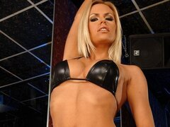 A blondie go-go girl shows off her sexy side as she does a sexy pole dance
