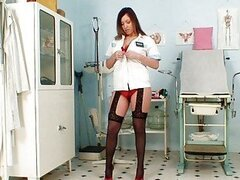 Busty pale nurse in red lingerie plays with speculum