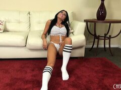Wearing only her bra and panties Romi Rain teases for the camera