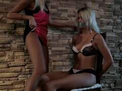 Tied blonde girl with a gag in her mouth gets fucked by other girl