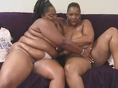 Huge black lesbians with a big toy