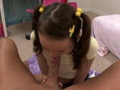 Pigtailed teen takes it deep into her throat